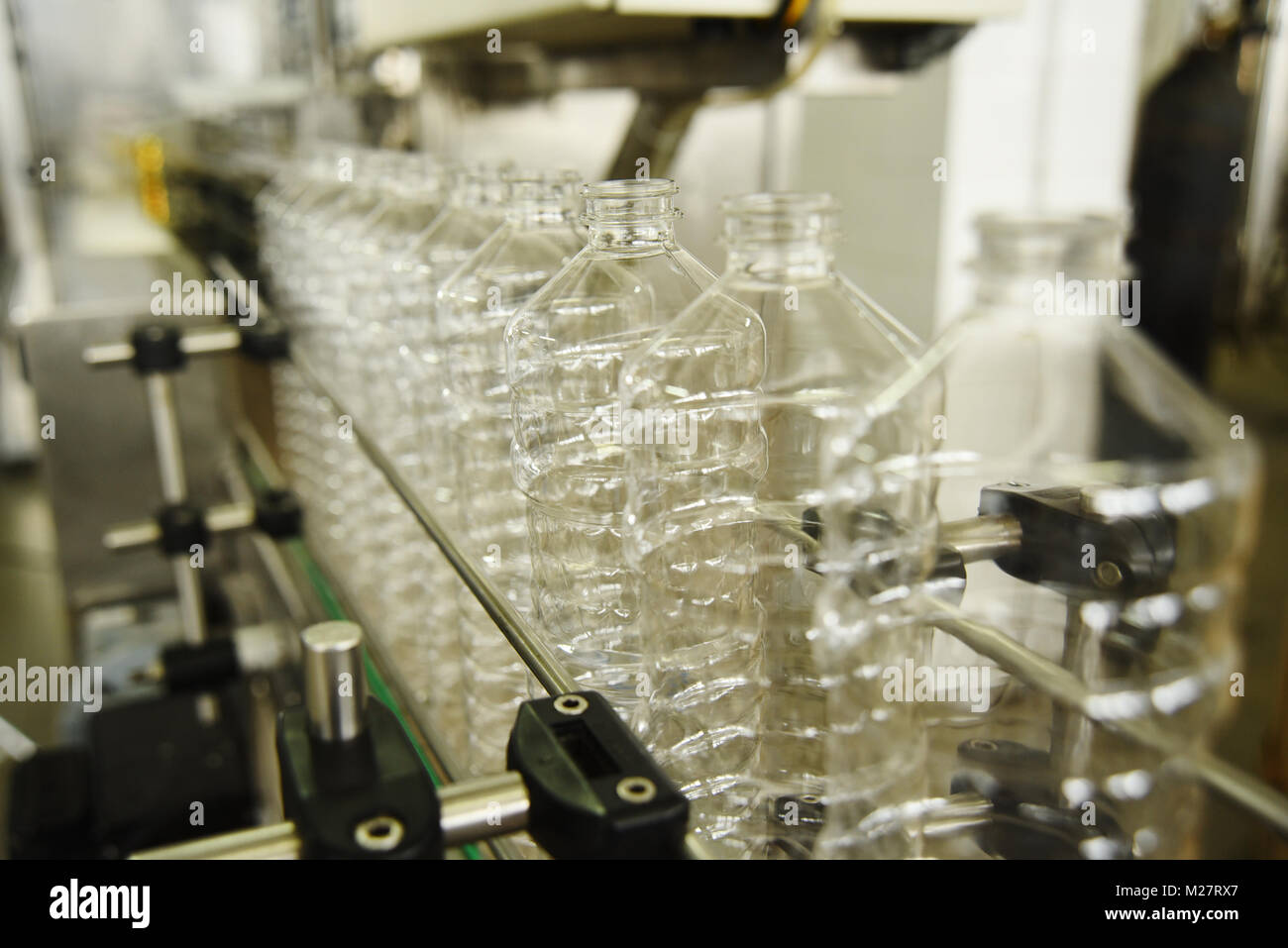 Bottle. Industrial production of PET bottles. Transparent packaging for food products - Stock Image