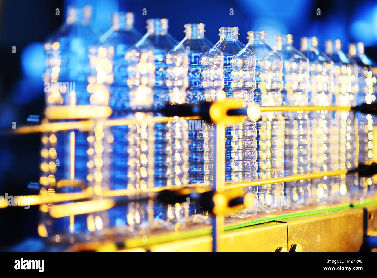 conveyor line for the production of plastic bottles close-up - Stock Image