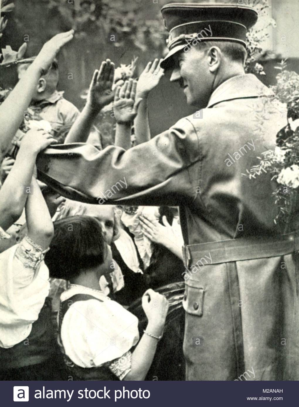 Adolf Hitler greets crowd during a visit to a German town, c1938 - Stock Image