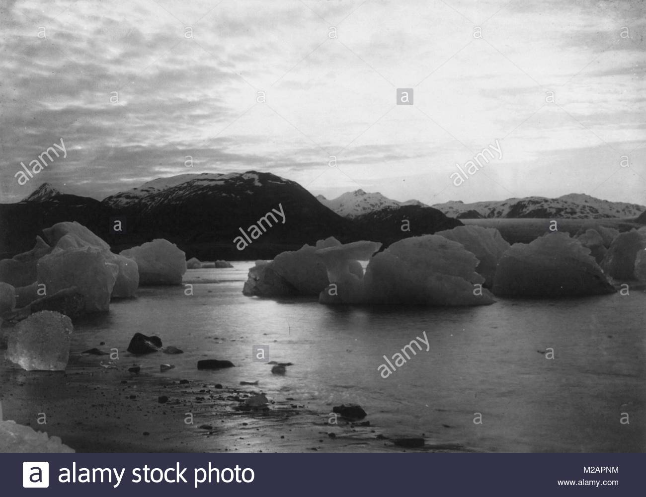 Photograph of large ice formations in water - Stock Image
