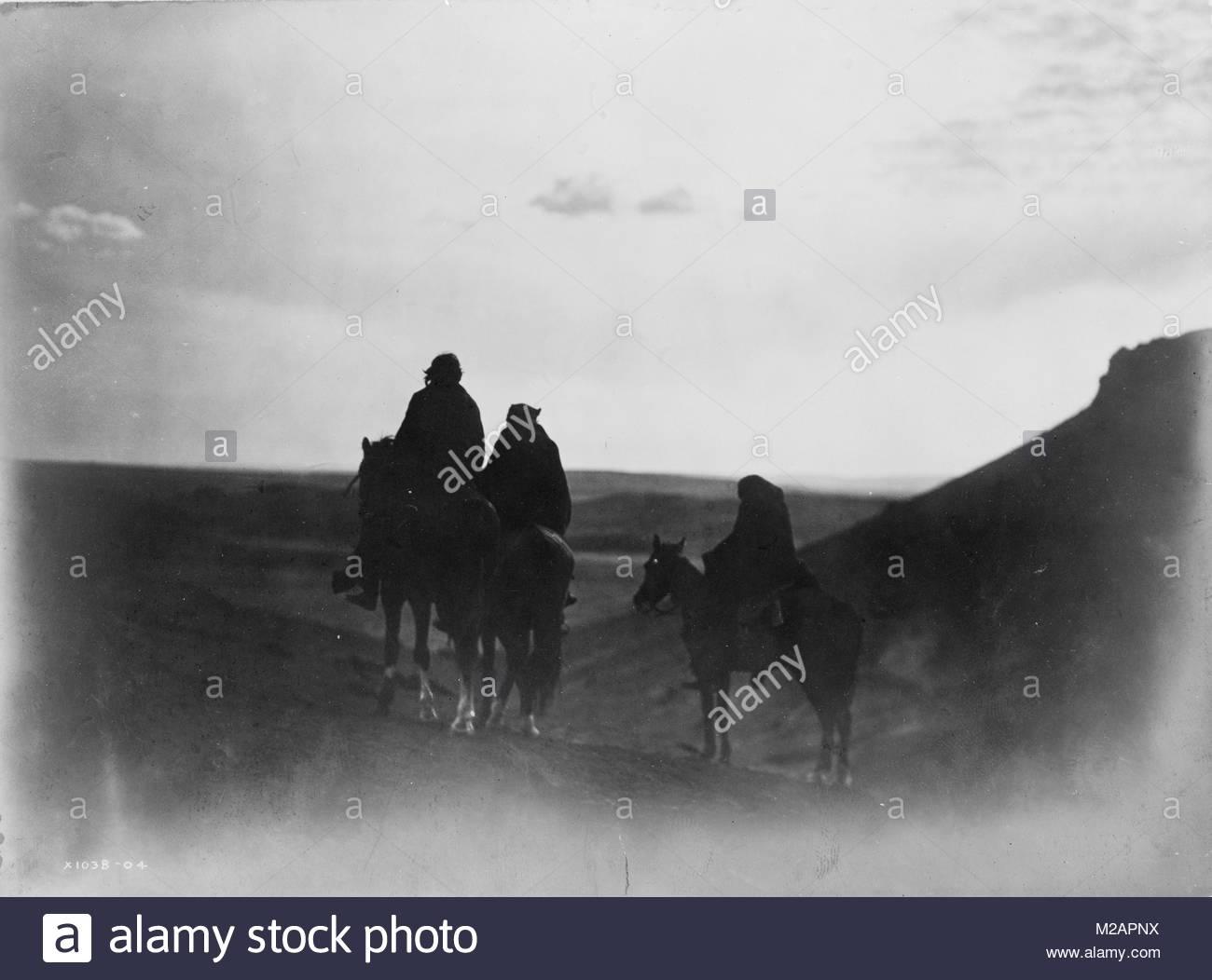 Three Navaho Indians on horseback - Stock Image