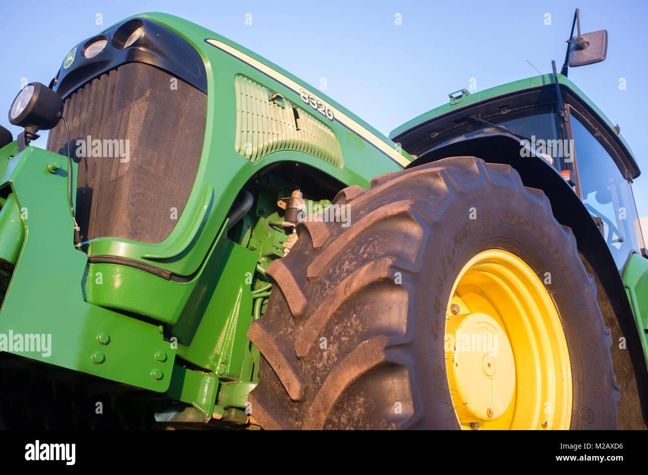 Badajoz, Spain - August 6th, 2017: Row Crop Tractor John Deere 8320. Low side view - Stock Image