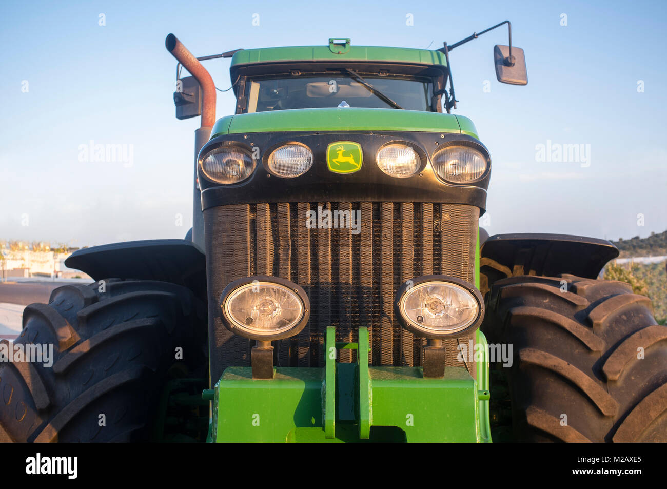Badajoz, Spain - August 6th, 2017: Row Crop Tractor John Deere 8320. Front view - Stock Image