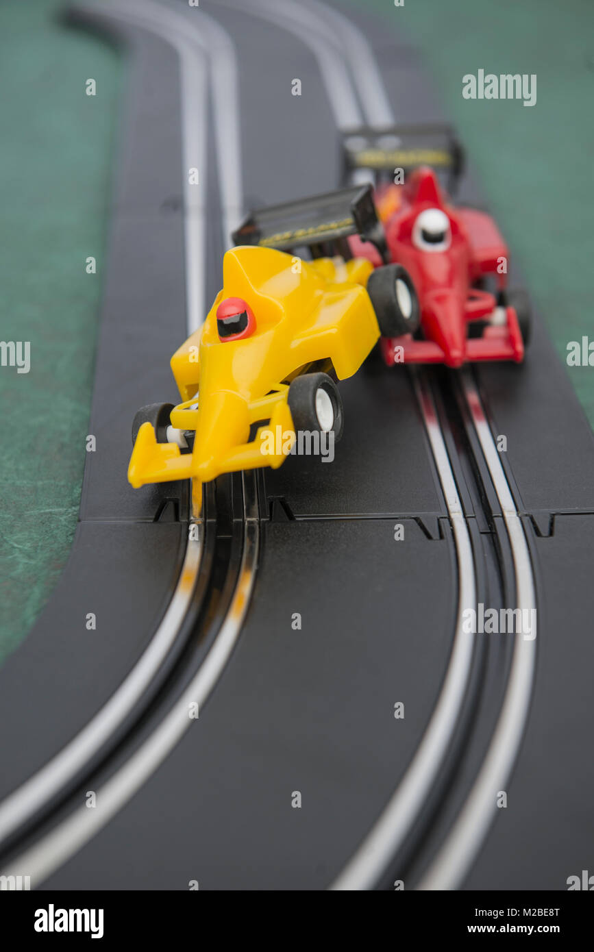 Cars on the track of a slot car racing game - Stock Image
