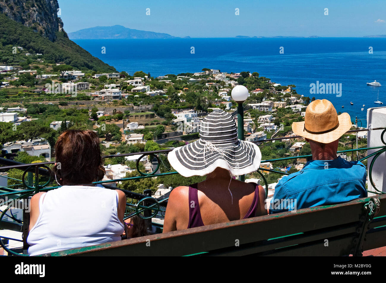 visitors looking out to the bay of naples from the island of capri, italy, - Stock Image