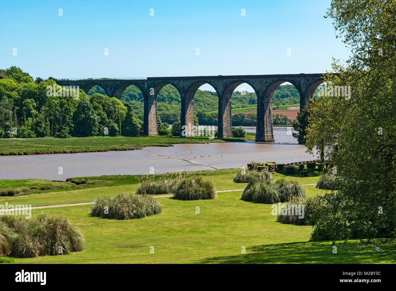 st.germans viaduct that takes the trains from cornwall to devon over the river tiddy viewed from the port eliot - Stock Image