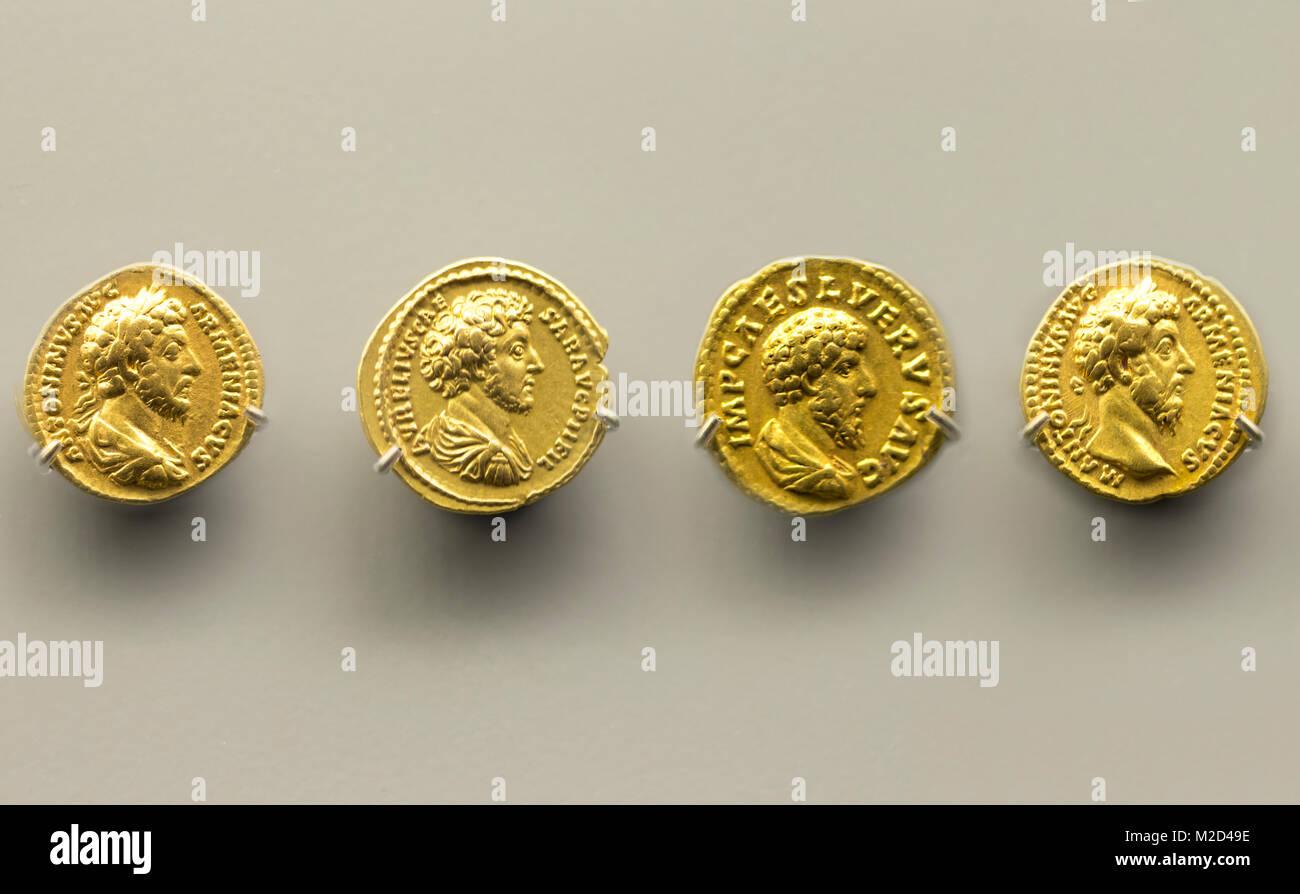 Merida, Spain - December 20th, 2017: Four golden coins of Marcus Aurelius Emperor at National Museum of Roman Art - Stock Image