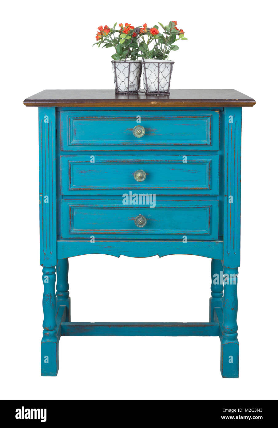 Vintage Furniture - Vintage turquoise commode (Chest of Drawers) with 3 drawers with brass fittings and flower planter - Stock Image