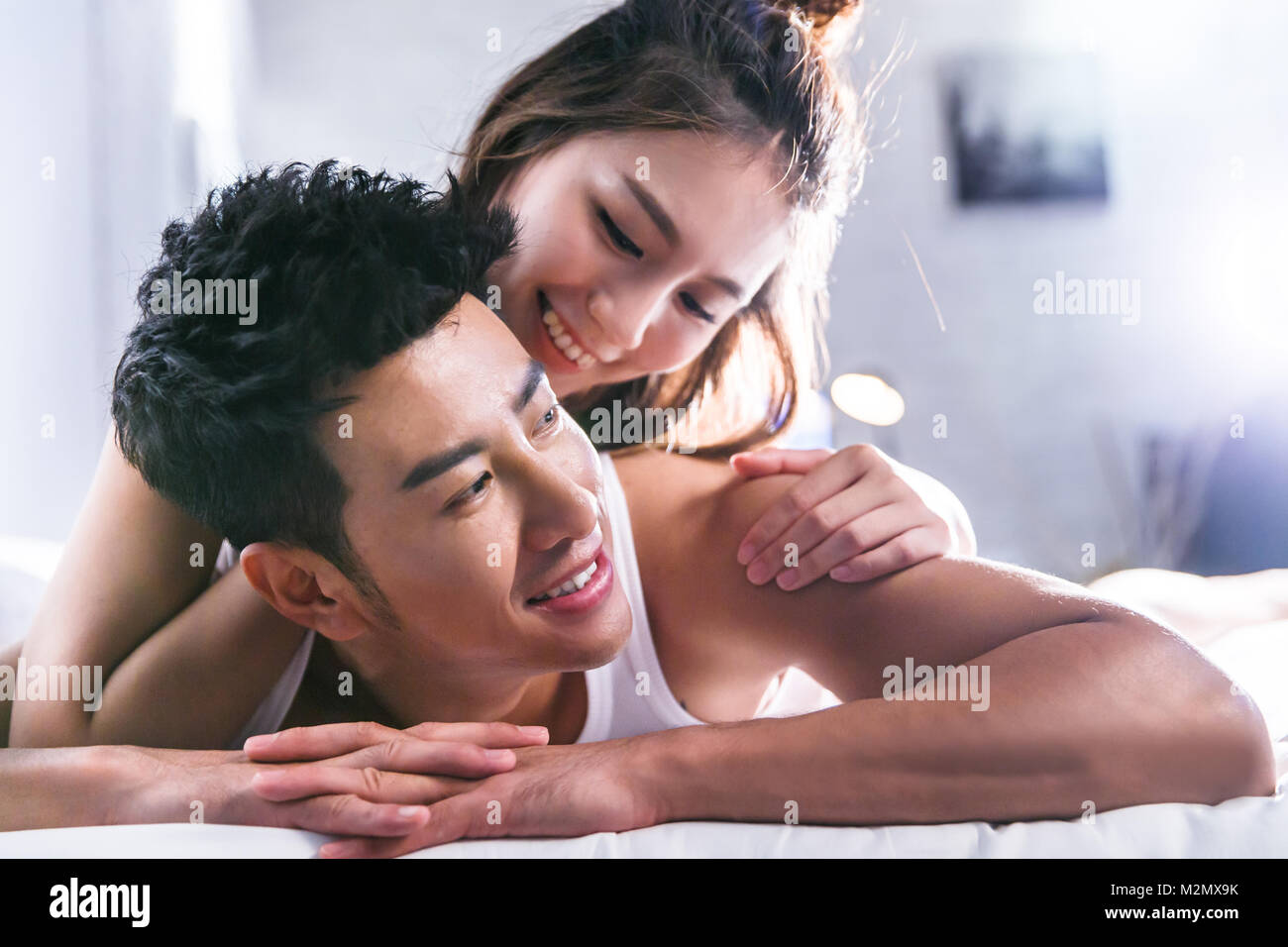 Young lovers are in bed - Stock Image