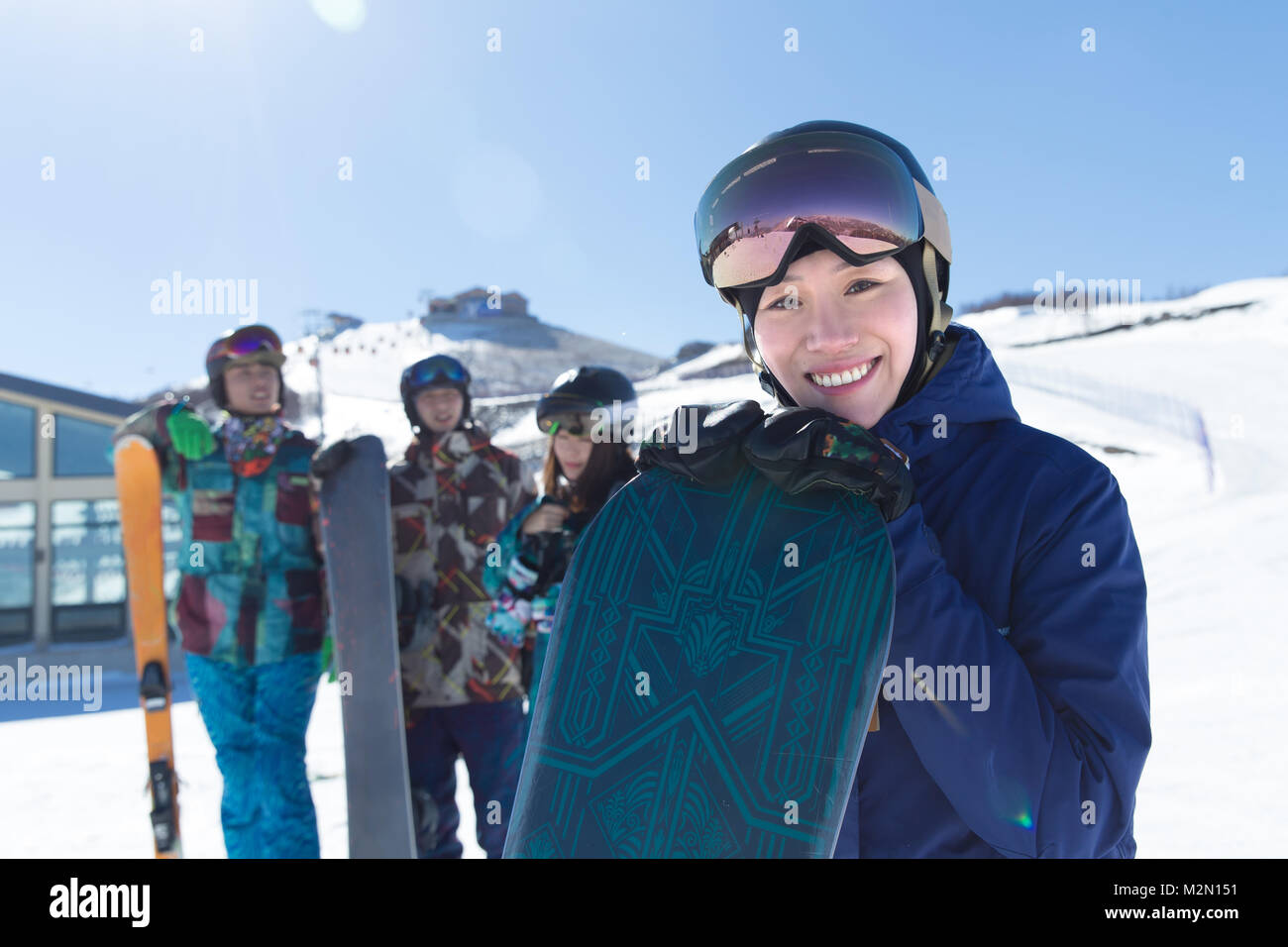 Young men and women outdoor skiing - Stock Image