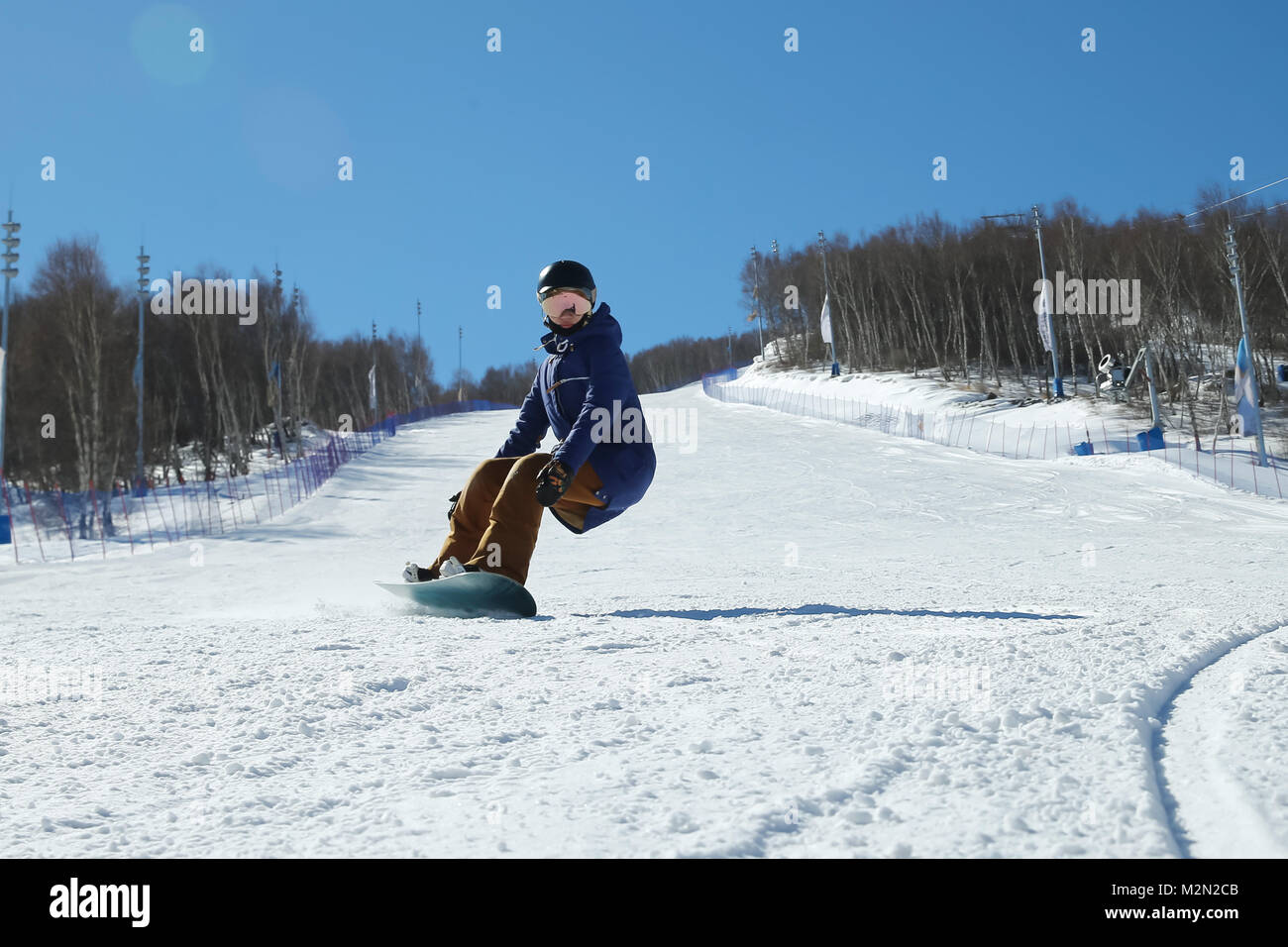Young woman outdoor skiing - Stock Image
