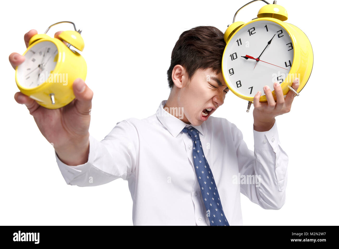 Business young man with an alarm clock - Stock Image