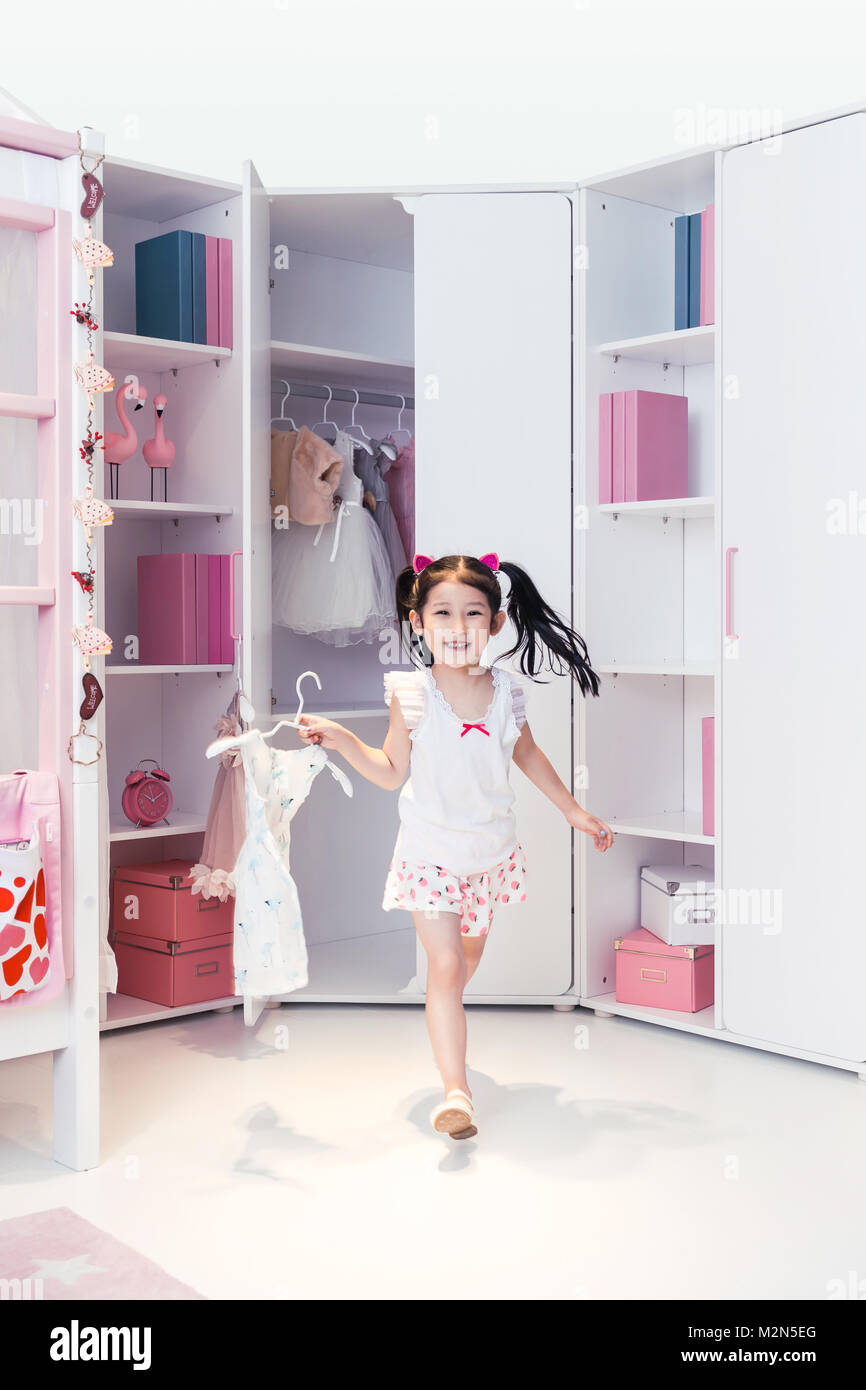 Lovely little girl in the bedroom - Stock Image