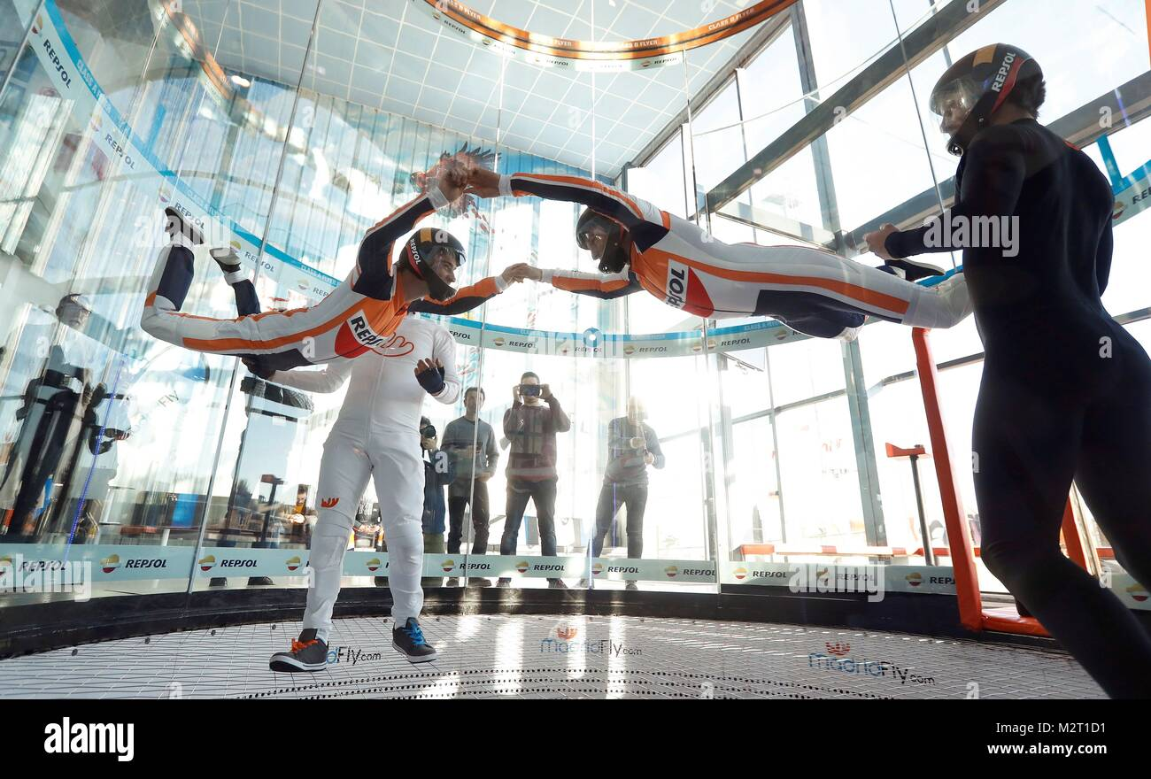 Madrid, Spain. 08th Feb, 2018. Spanish MotoGP rider Dani Pedrosa (L) and Marc Marquez fly in a wind tunnel during - Stock Image