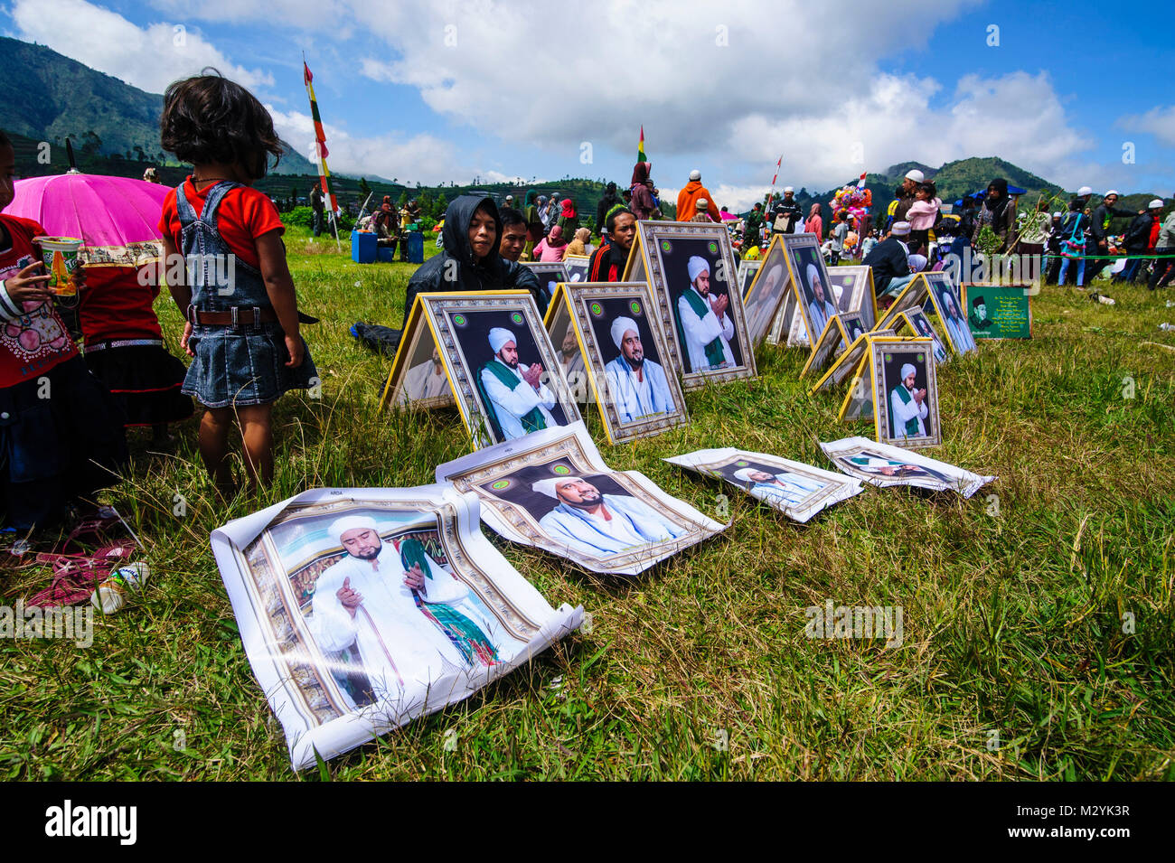 Muslim leader photos for sale at a Muslim festival at the Arjuna Hindu Dieng temple complex , Dieng Plateau, Java, - Stock Image
