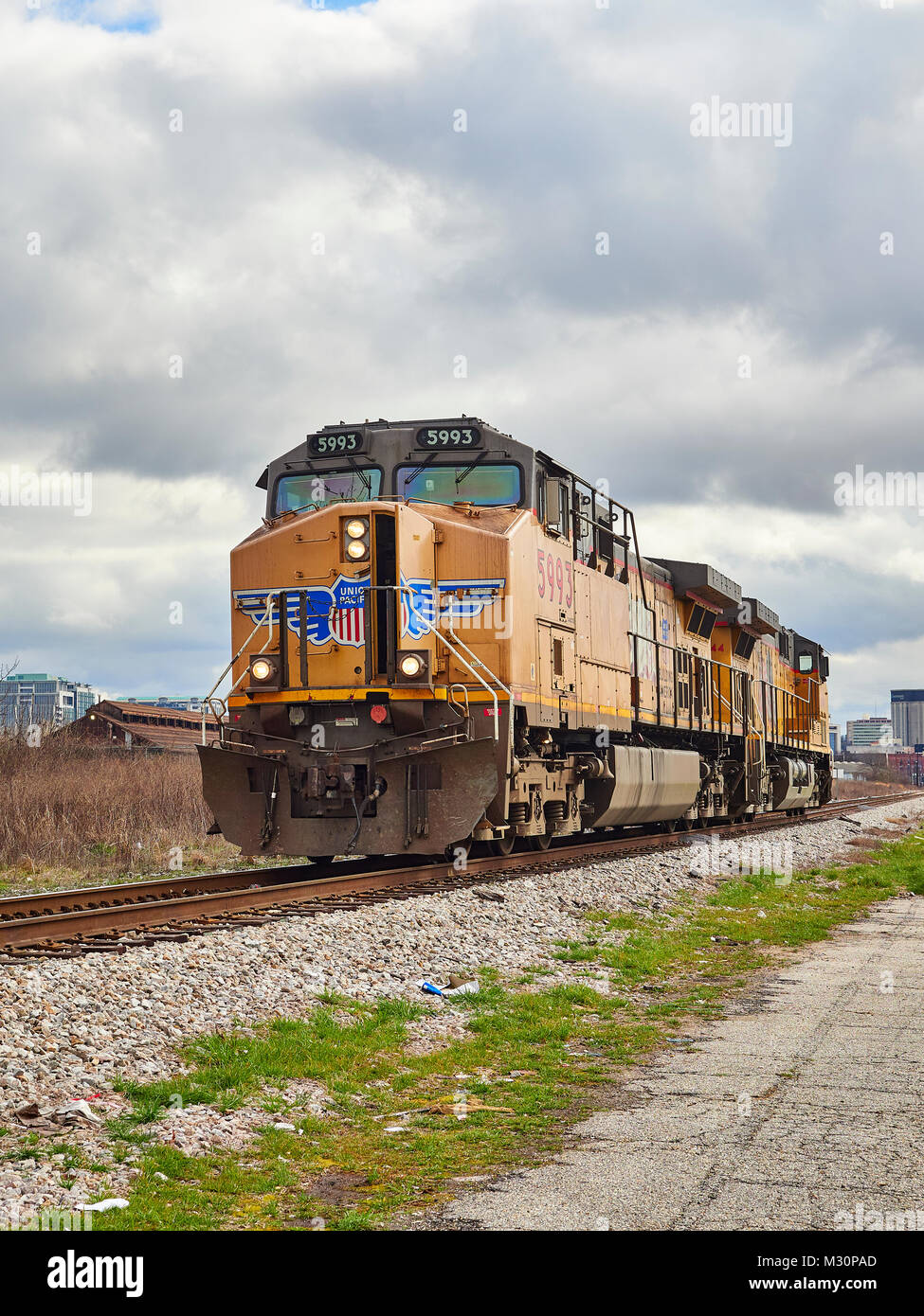 Union Pacific diesel locomotive #5993 traveling along a railroad siding in Montgomery Alabama, USA. - Stock Image
