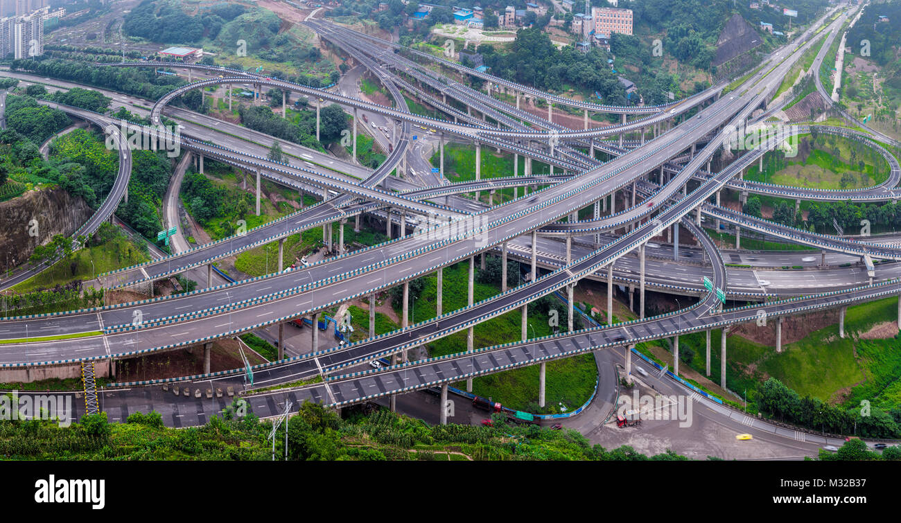 Chongqing Huang Jue Wan overpass and city building scenery - Stock Image