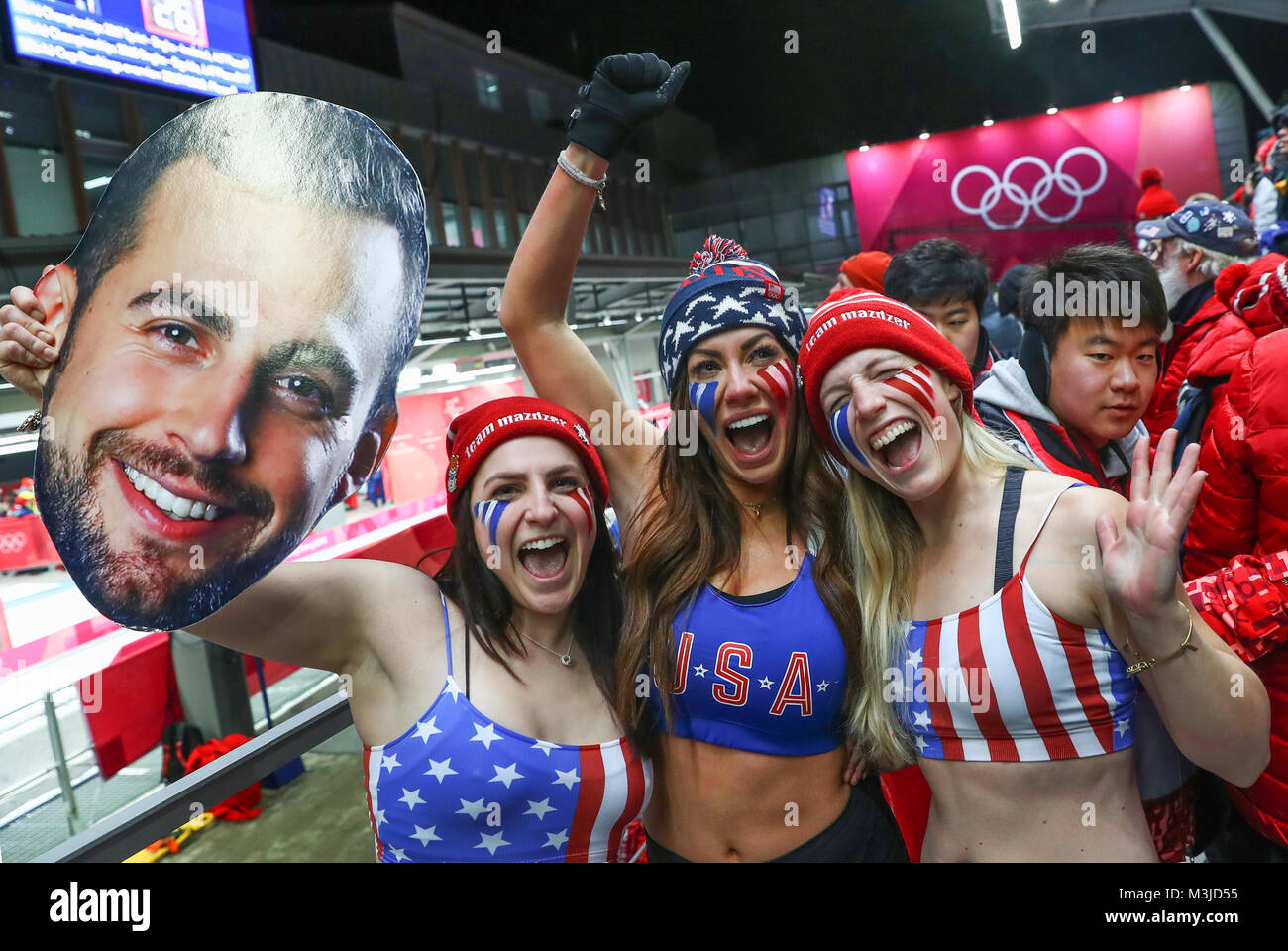 Pyeongchang, South Korea. 11th February, 2018. Fans of the American luge athelete Mazdzer cheering during the men's - Stock Image
