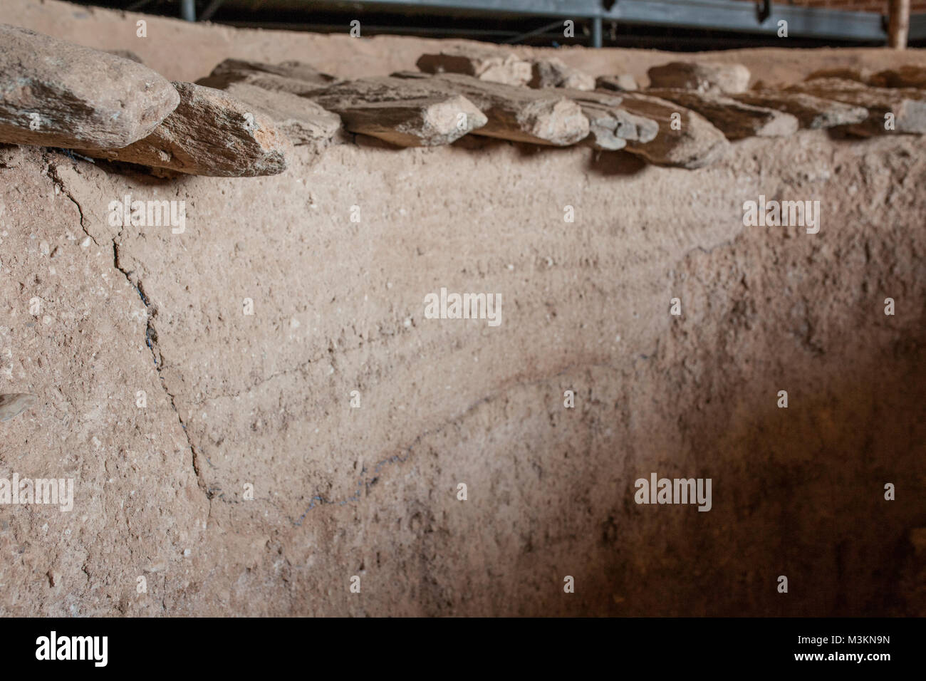Archeological site of Huerta Montero, Almendralejo, Spain. Mud wall and first line of false dome roof - Stock Image