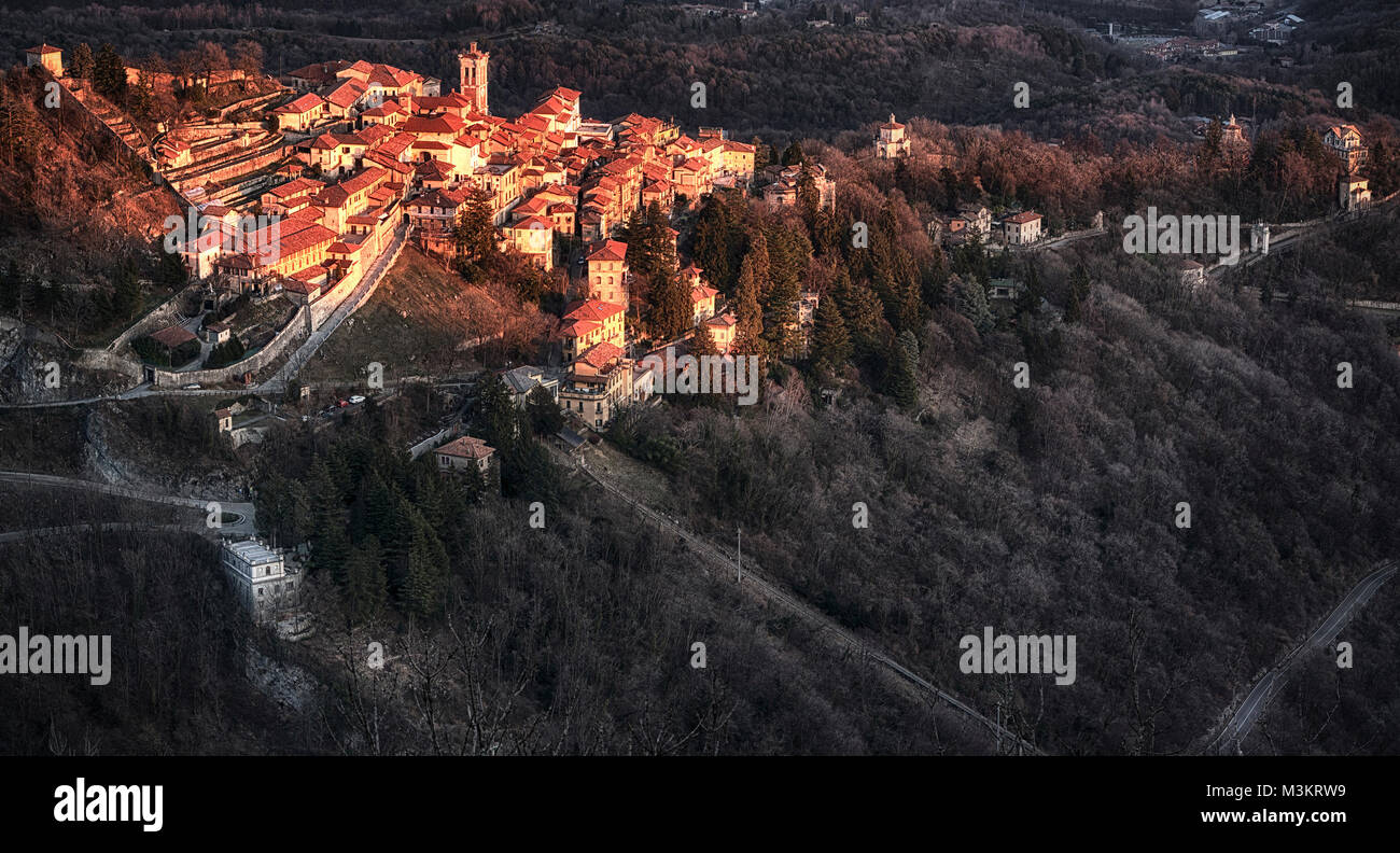 Warm sunny light on the ancient village of Sacred Mount of Varese in a winter afternoon - Stock Image
