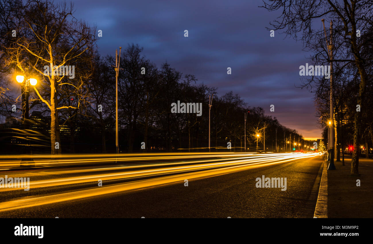 Lights on The Mall after sunset; Buckingham Palace in the background, London, UK - Stock Image