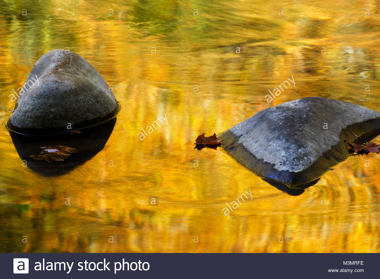 Autumn reflections along Little River, in the Great Smoky Mountains National Park. - Stock Image