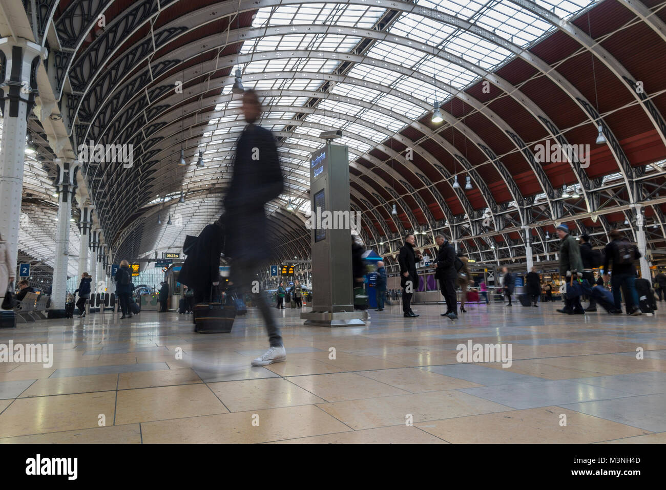 Commuters rushing to catch a train at Paddington station, London - Stock Image