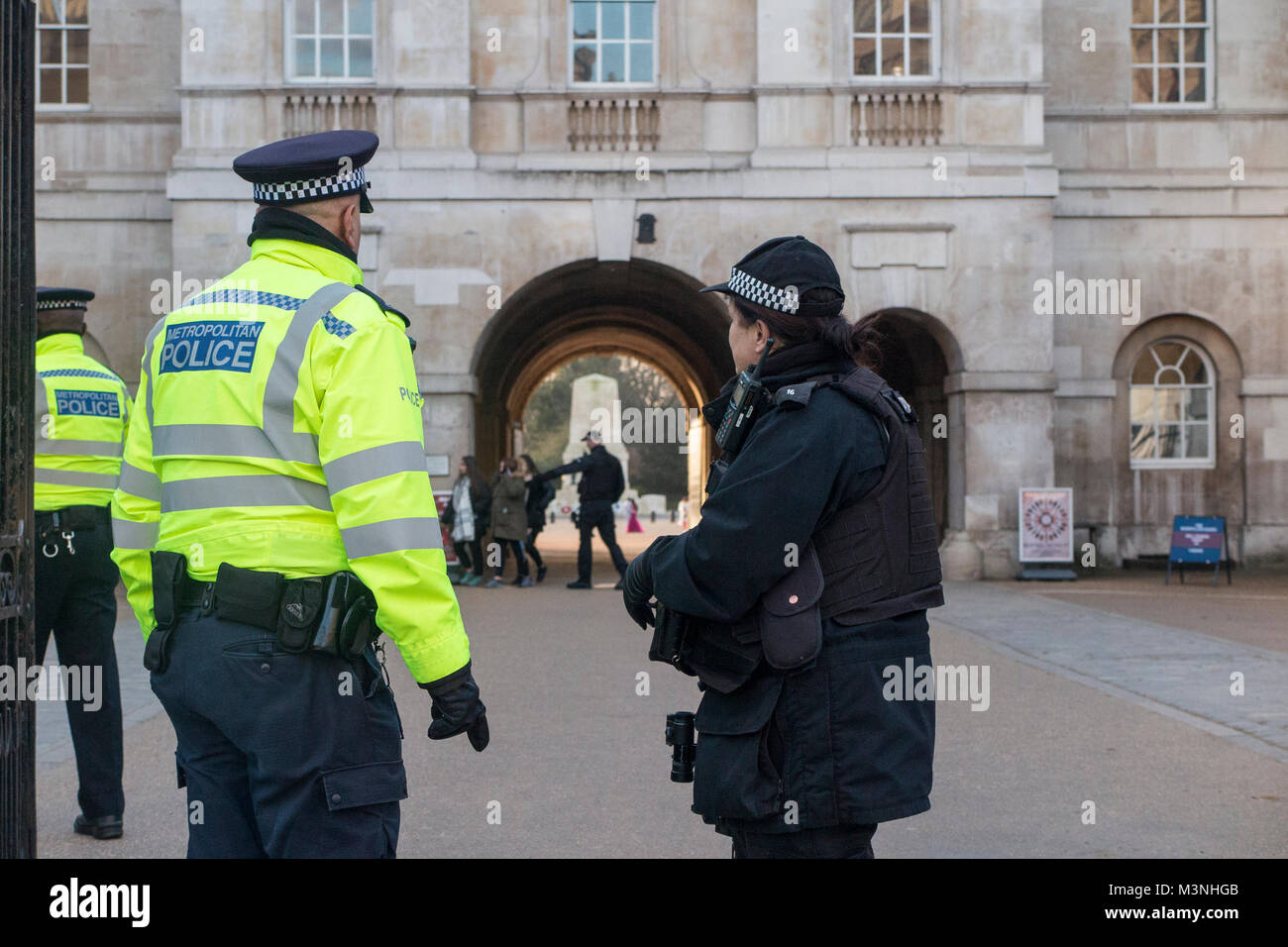 An armed police woman in London - Stock Image