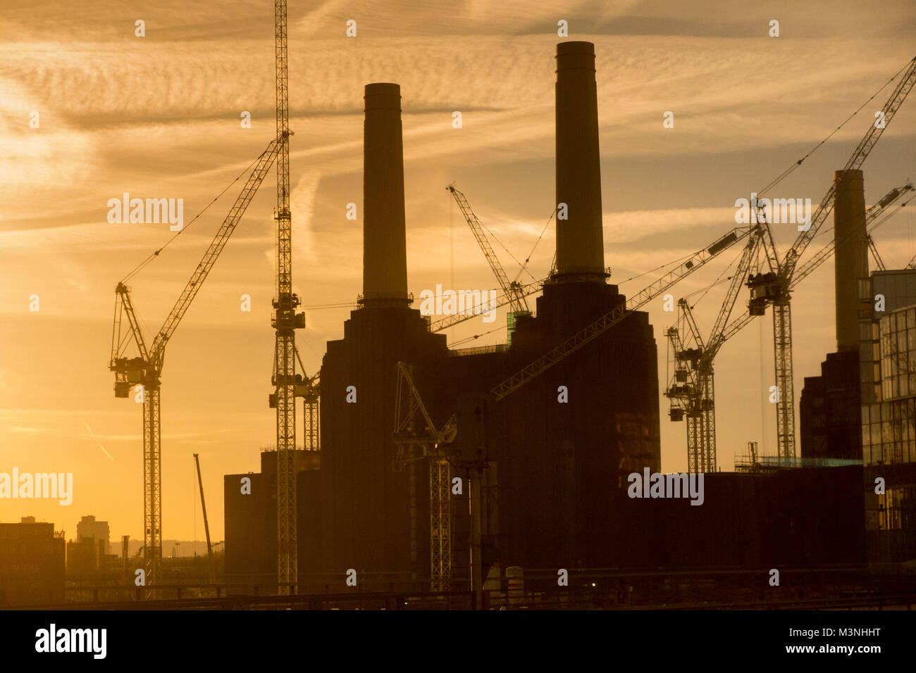 Early morning silhouetted Battersea Power Station - Stock Image