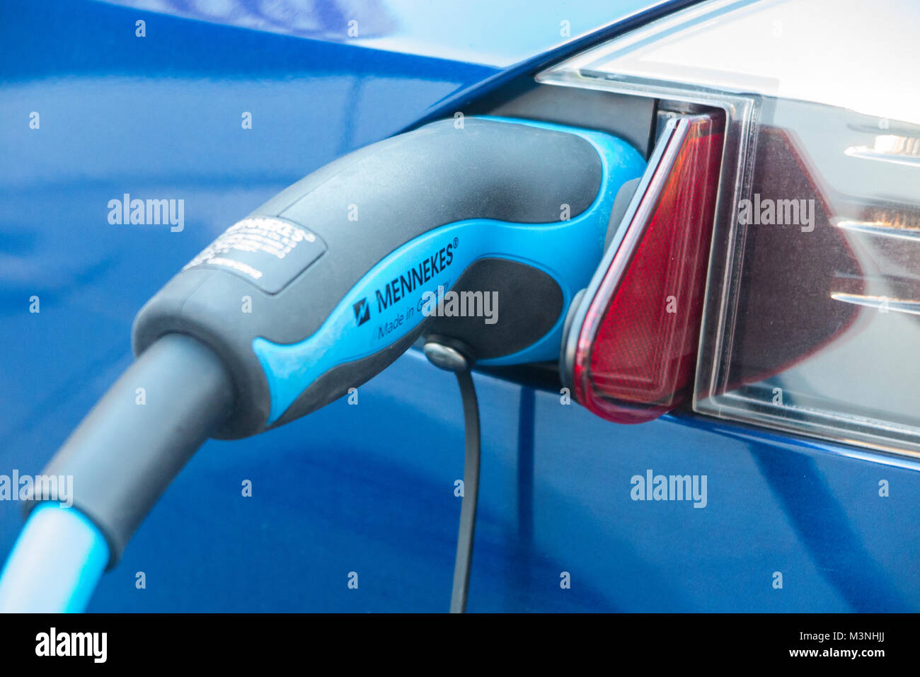 Charging an electric car - Stock Image