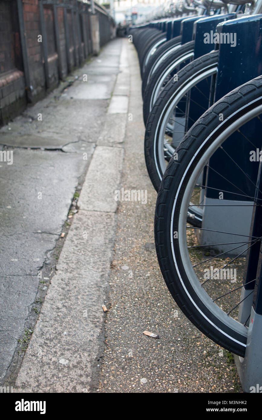 Many, many bike wheels lined up in London - Stock Image