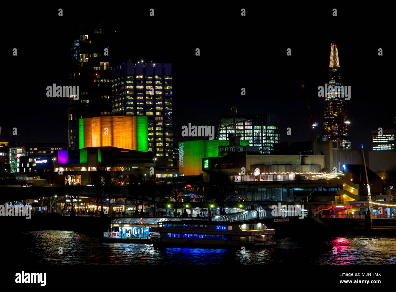 The bright lights of London's South Bank at night - Stock Image