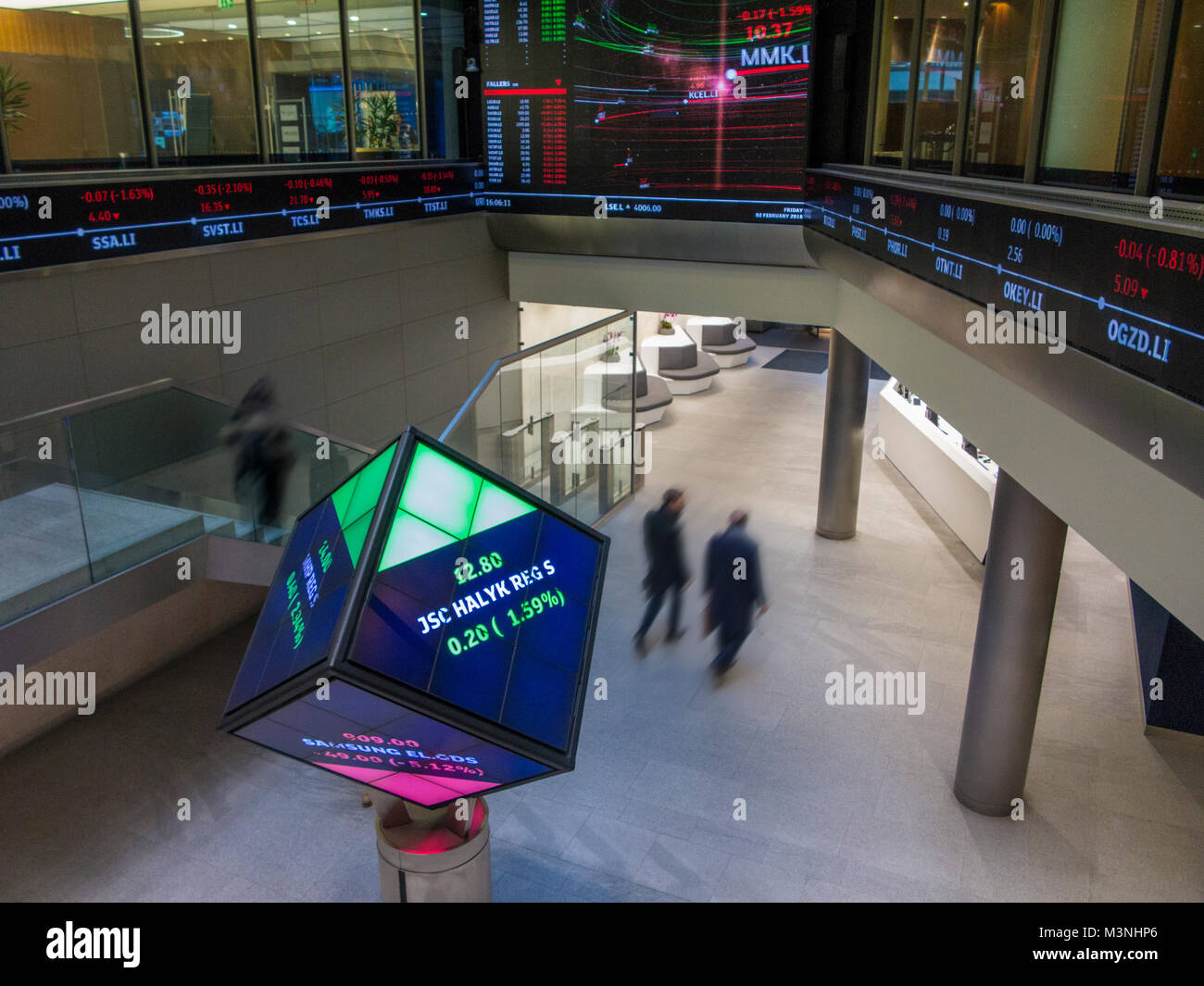 The interior of the London stock Exchange wit blurred figures coming and going to work - Stock Image