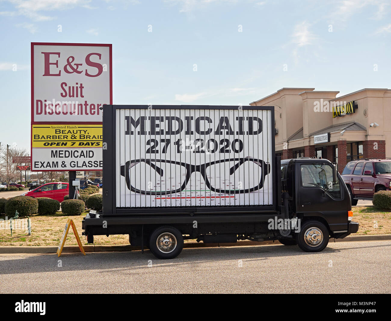Large sign on a truck advertising Medicaid free eye exams for the poor in Montgomery, Alabama USA.  Free healthcare - Stock Image