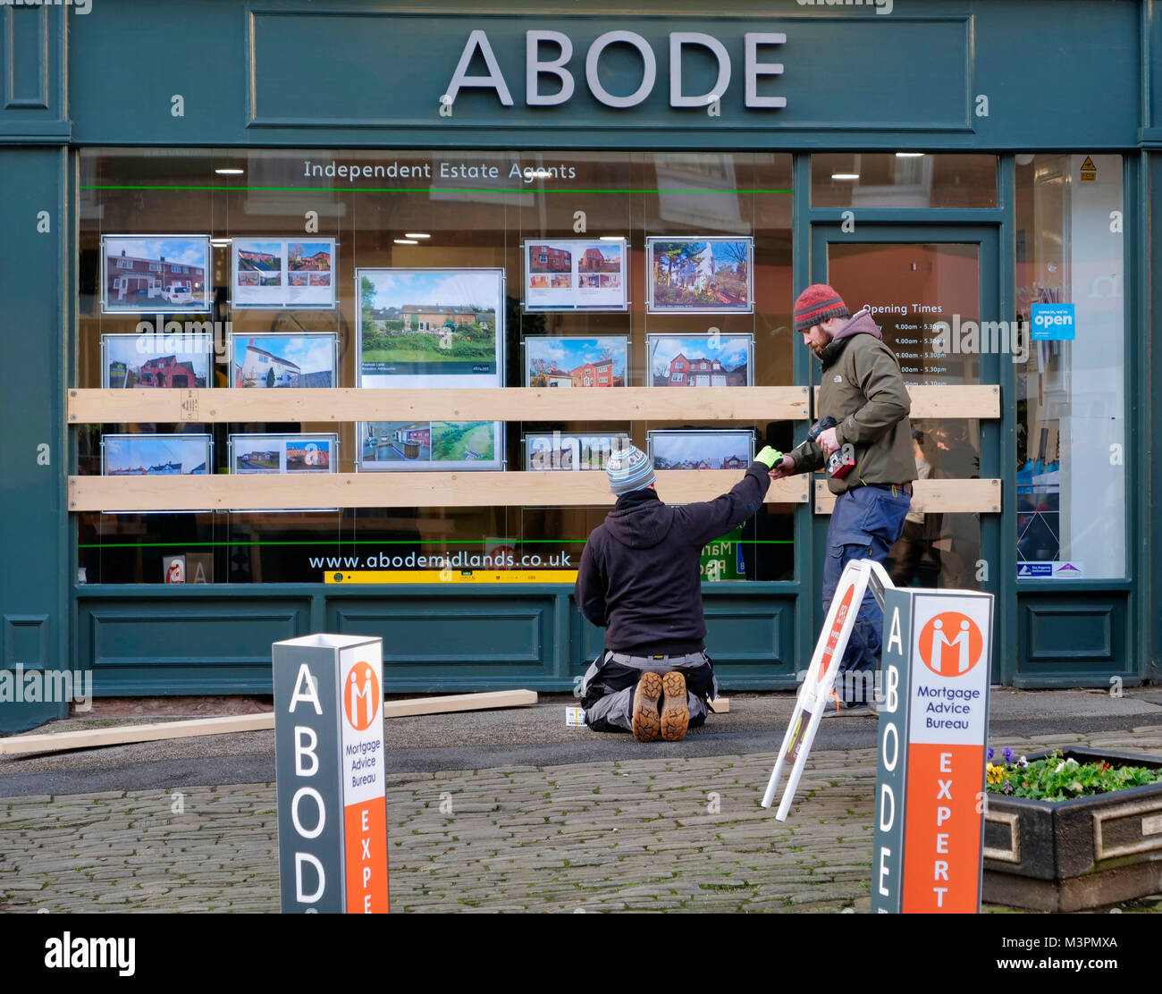 Ashbourne, UK. 12th February, 2018. All boarded up. Ashbourne town centre shop windows are boarded up for the start - Stock Image
