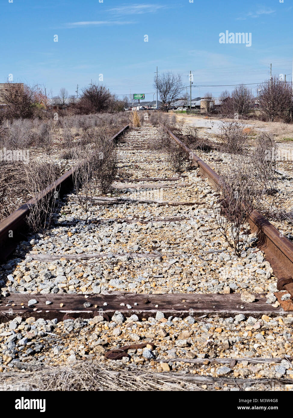 Abandoned railroad or railway track or tracks in urban Montgomery, Alabama USA. - Stock Image