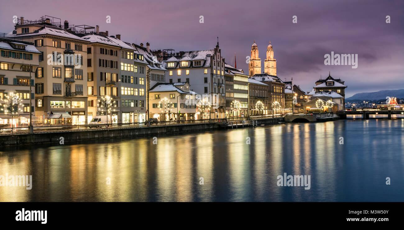 Christmas illumination Limmatquai, Grossmunster cathedral, winter, snow, Zurich, Switzerland - Stock Image