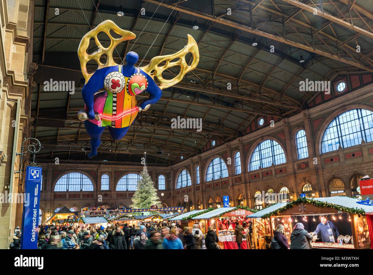 Christmas market Zurich main station, guardian angel by Niki de St. Phalle, Zurich, Switzerland - Stock Image