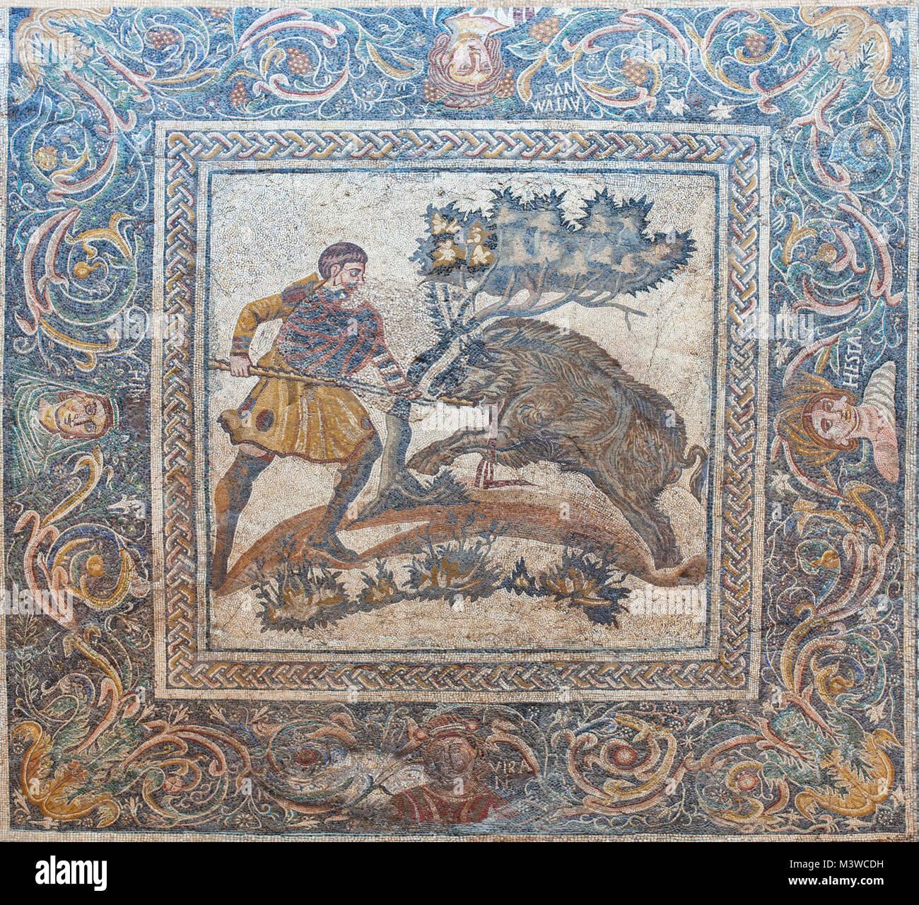 Merida, Spain - December 20th, 2017: Wild boar hunting mosaic. National Museum of Roman Art in Merida, Spain - Stock Image
