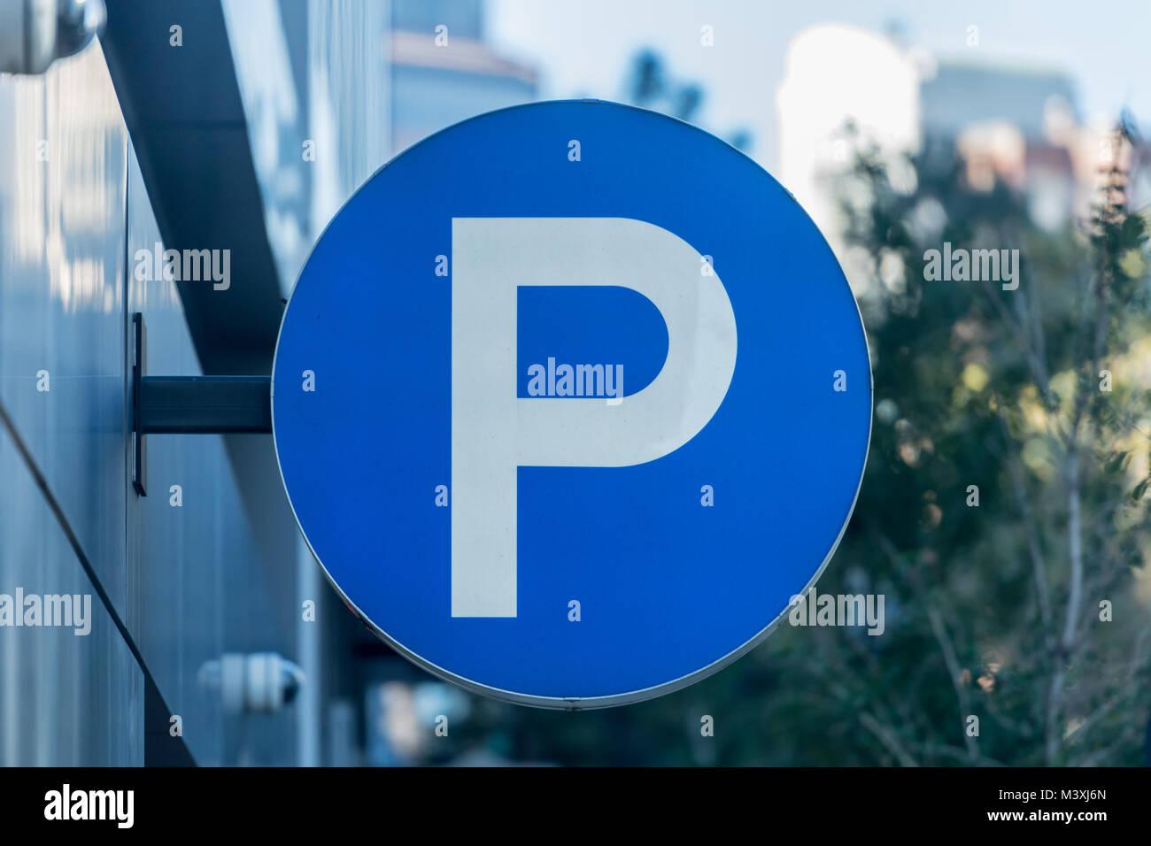 Large P Parking Sign along city parking deck - Stock Image