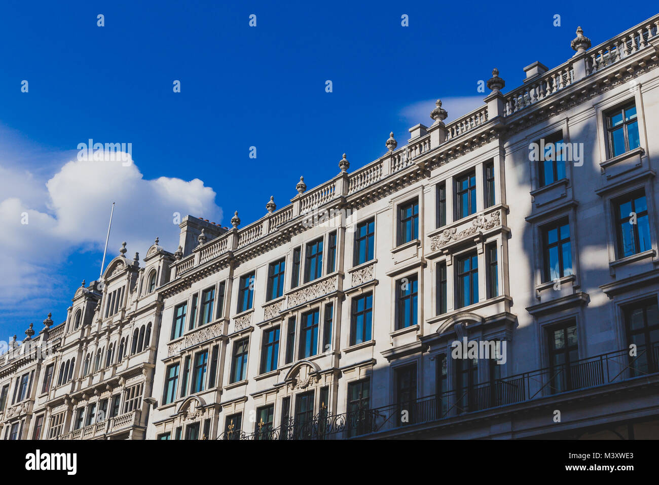 LONDON, UNITED KINGDOM - August, 22th, 2015: detail of Regent Street in central London under a vibrant sky - Stock Image
