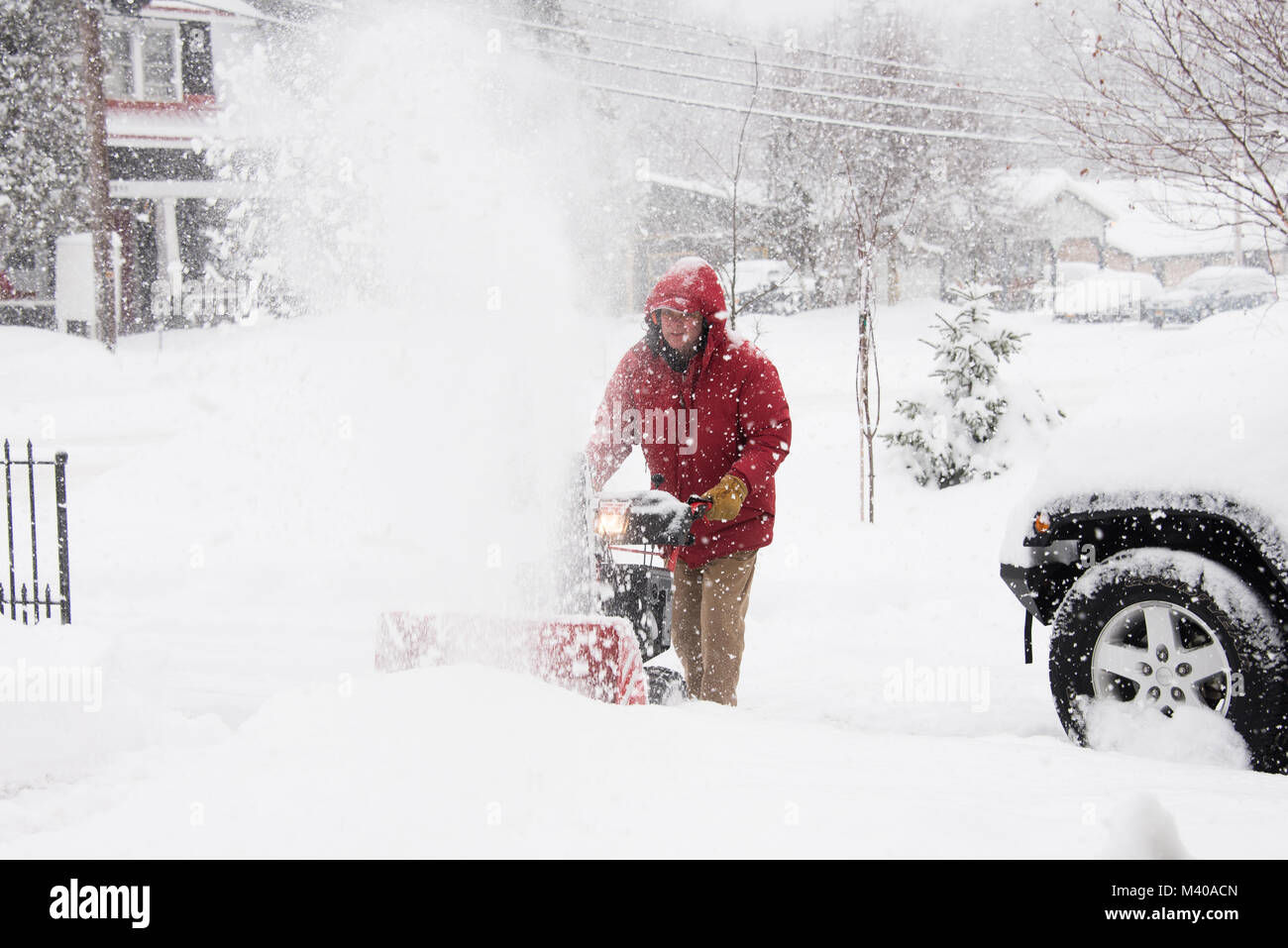 man-running-a-snowblower-blowing-snow-fr