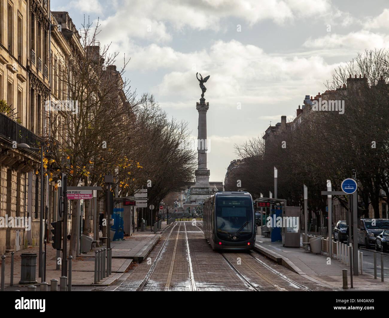 BORDEAUX, FRANCE - DECEMBER 27, 2017: Bordeaux tram stop on line C (Jardin Public) with the monumental column of - Stock Image