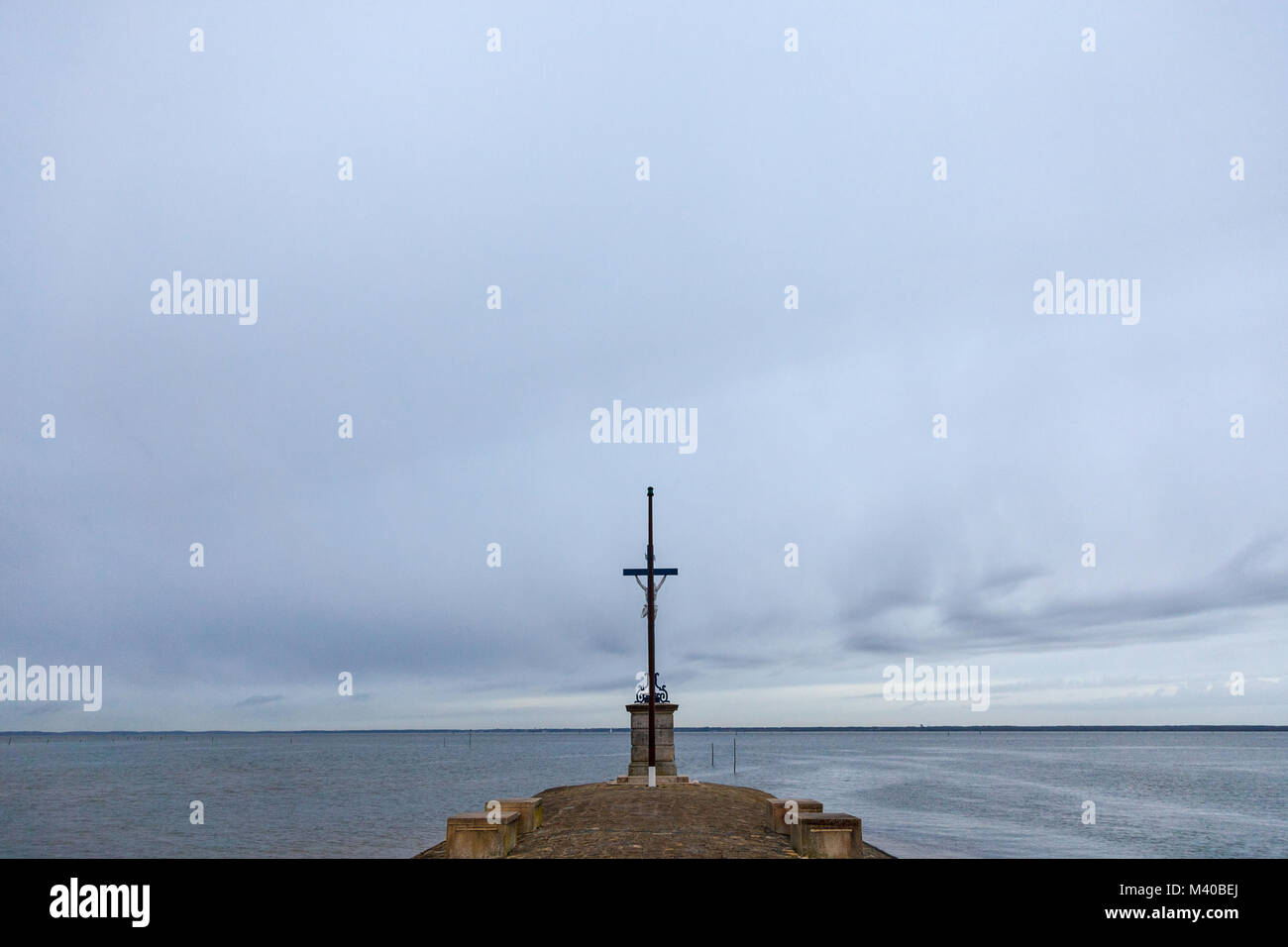 Sailors Cross (Croix des Marins) during a cloudy rainy afternoon in Gujan Mestras, France, on Bassin d'Arcachon. - Stock Image