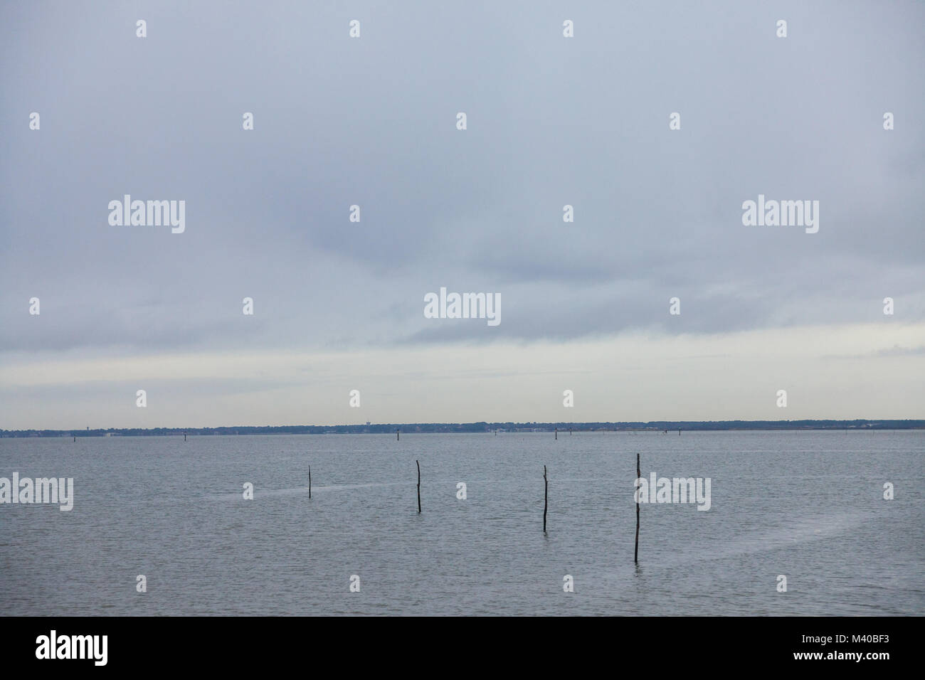 Atlantic ocean in Gujan Mestras, Bassin d'Arachon, France, during a storm on a cloudy rainy afternoon. This - Stock Image
