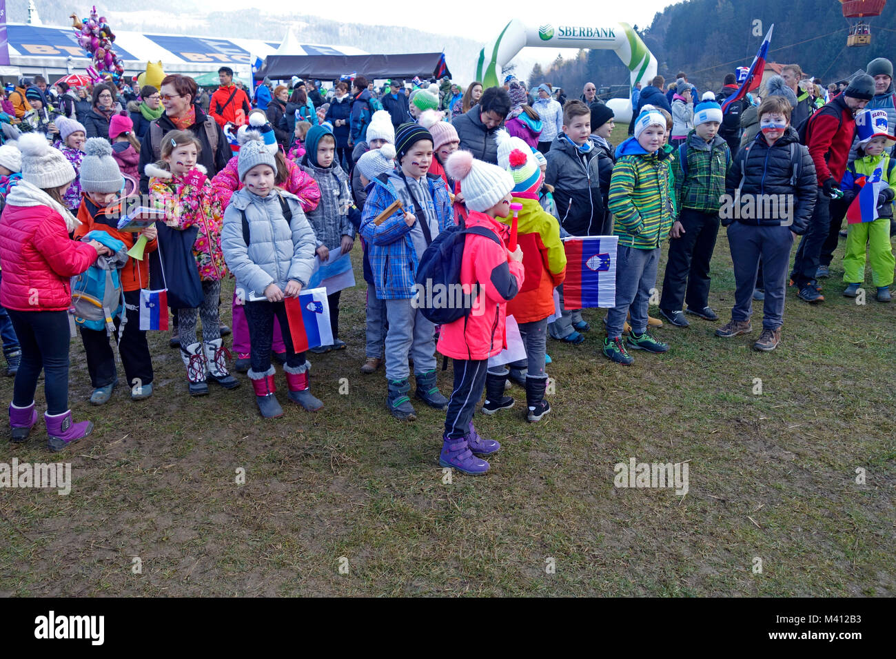 Children fans during ski jumping world cup competition in Ljubno ob Savinji. Stajerska, Slovenia. - Stock Image