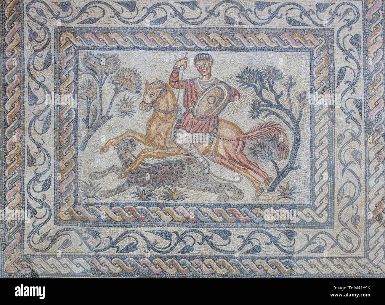 Merida, Spain - December 20th, 2017: Panther hunter roman  mosaic or Venatio. National Museum of Roman Art in Merida, - Stock Image