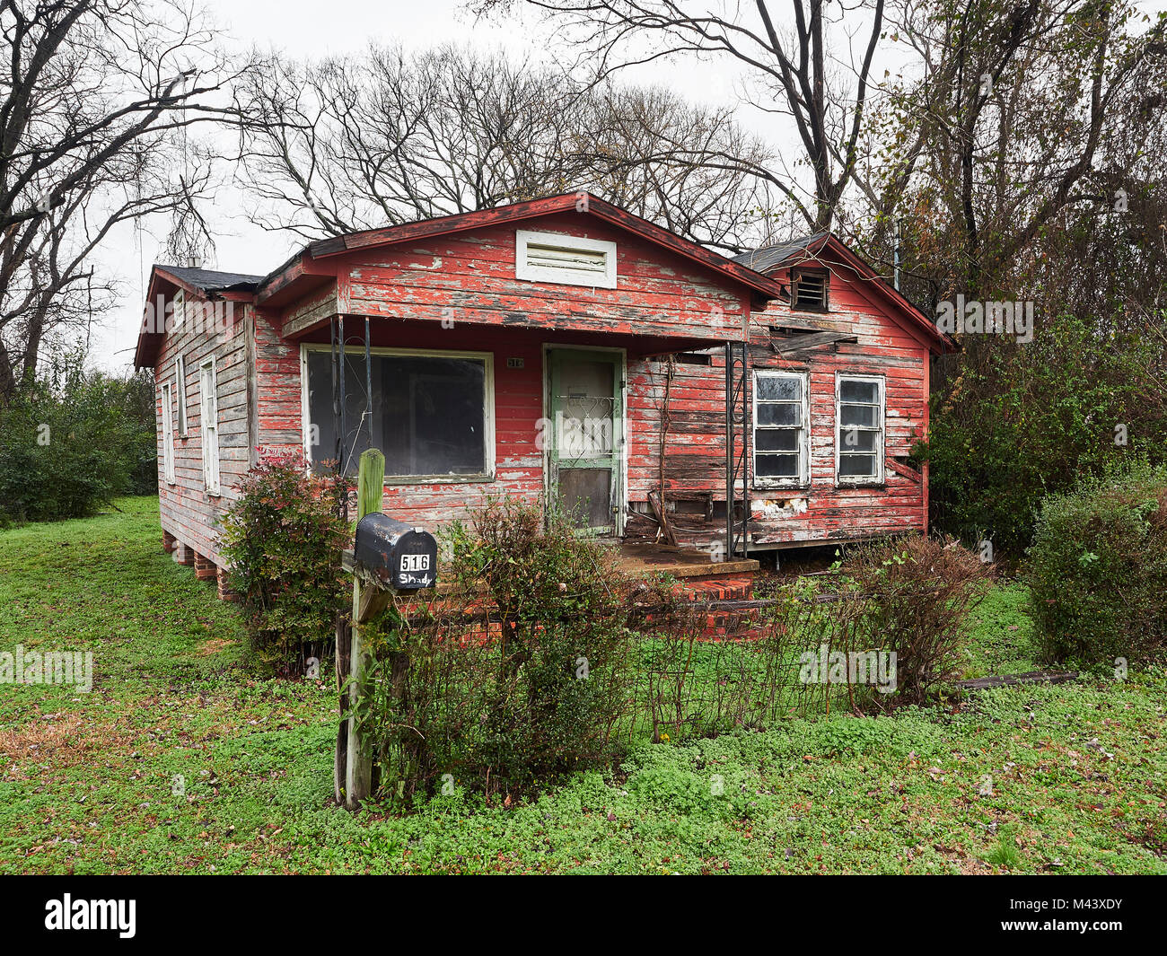 Vacant, empty or abandoned house or home in a poor area showing the level of poverty in the inner urban area of - Stock Image
