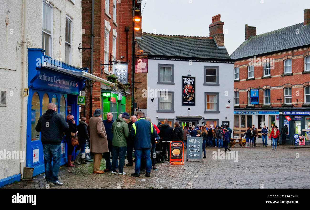 Ashbourne, UK. 14th Febraury, 2018. Celebrations, beer, fish & chips at the end of the wet two day Ashbourne - Stock Image