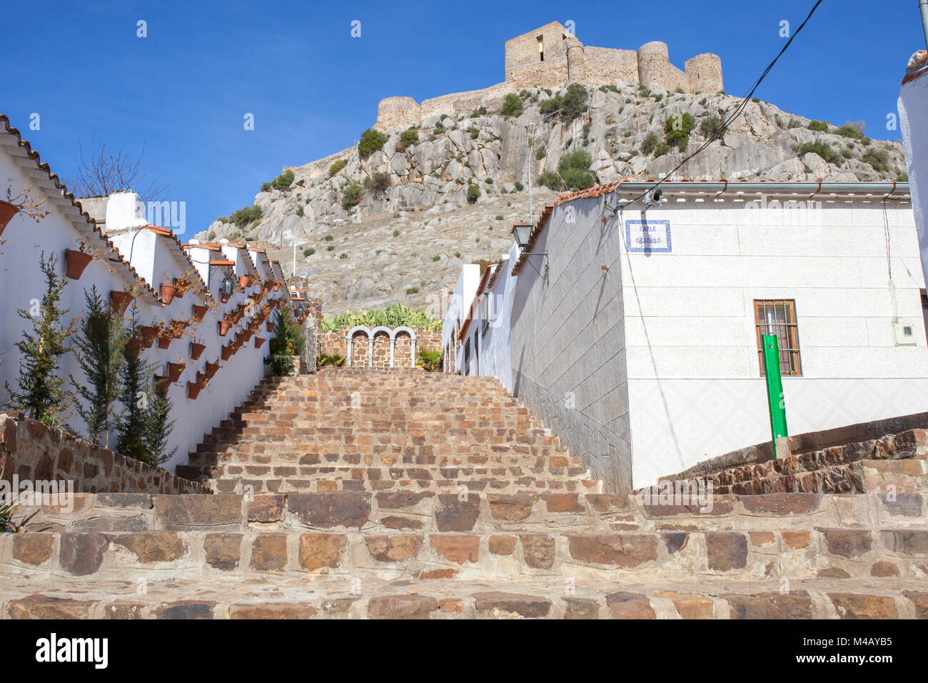 High rocky hill with Castle of Belmez, Cordoba, Spain. View from town streets. Rafael Canalejo staircase - Stock Image